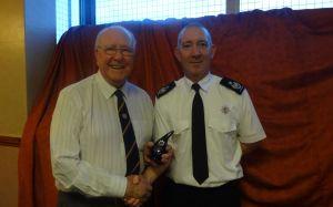Monty Britton receiving a Lifetime achievement award from the DCFO Jon Day